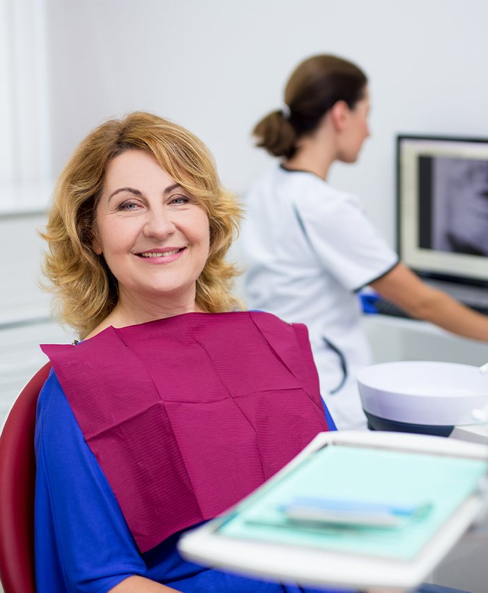 Woman smiling during sleep apnea oral appliance fitting appointment