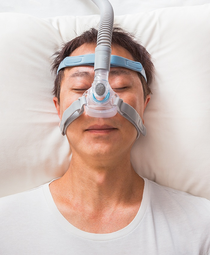 Patient with C PAP mask sleeping