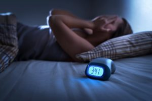 woman struggling with sleep apnea during the holidays